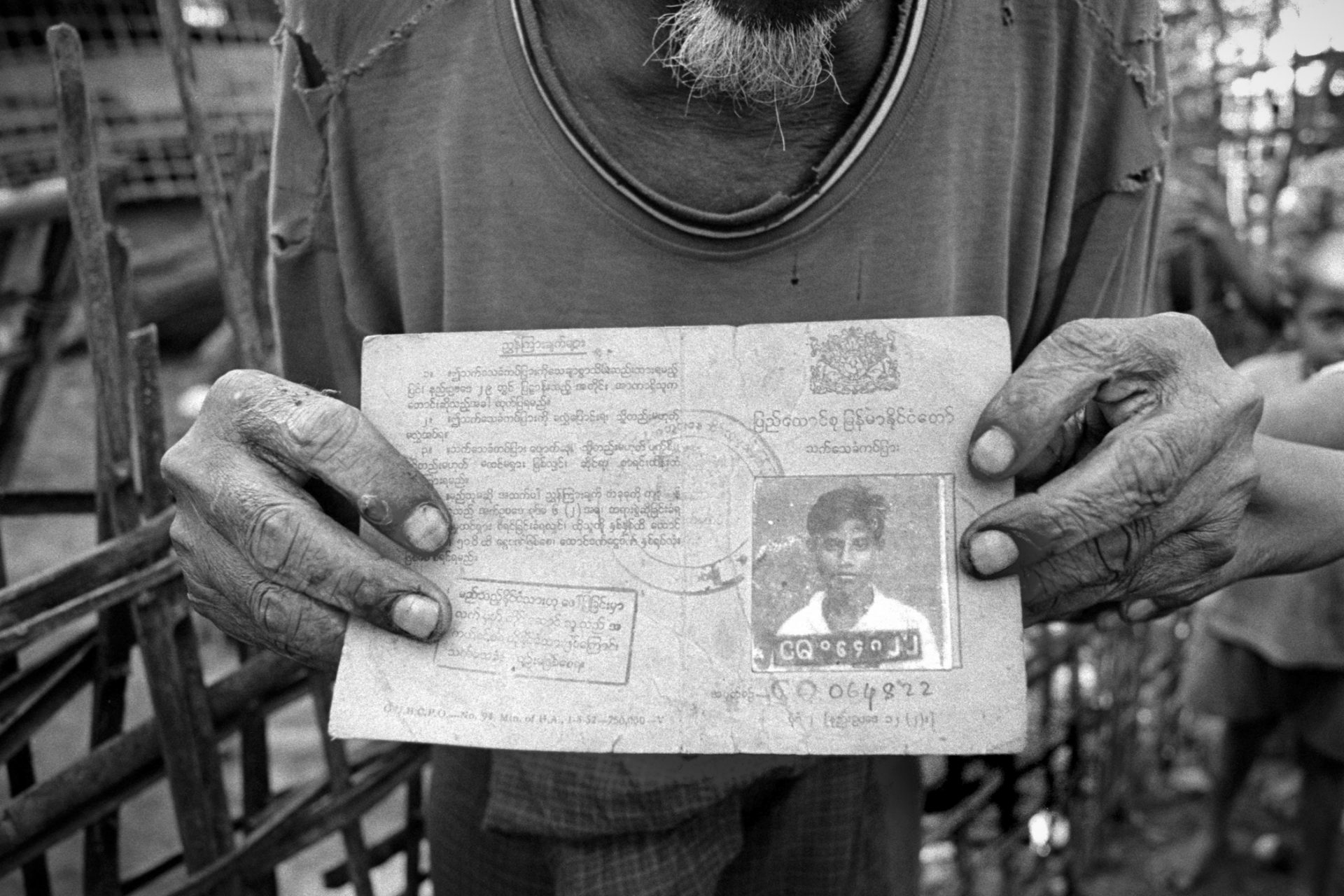 Mohamed Sorbodie holds his National Registration Card in Paungdaw Village, Mrauk U.  Rohingyas were considered citizens of Myanmar until The Burmese Citizenship Law of 1982 revoked their status and effectively made them stateless.