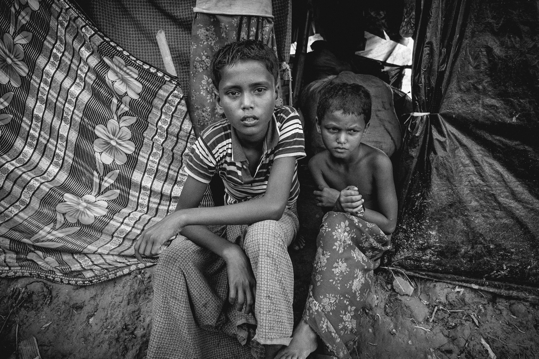 Kamal and his sister Anuwara witnessed the murder of both of their parents when the Myanmar military shot them outside of their house in Maungdaw, Myanmar.  They now currently reside with other Rohingyas in Balukhali makeshift refugee camp in Bangladesh.