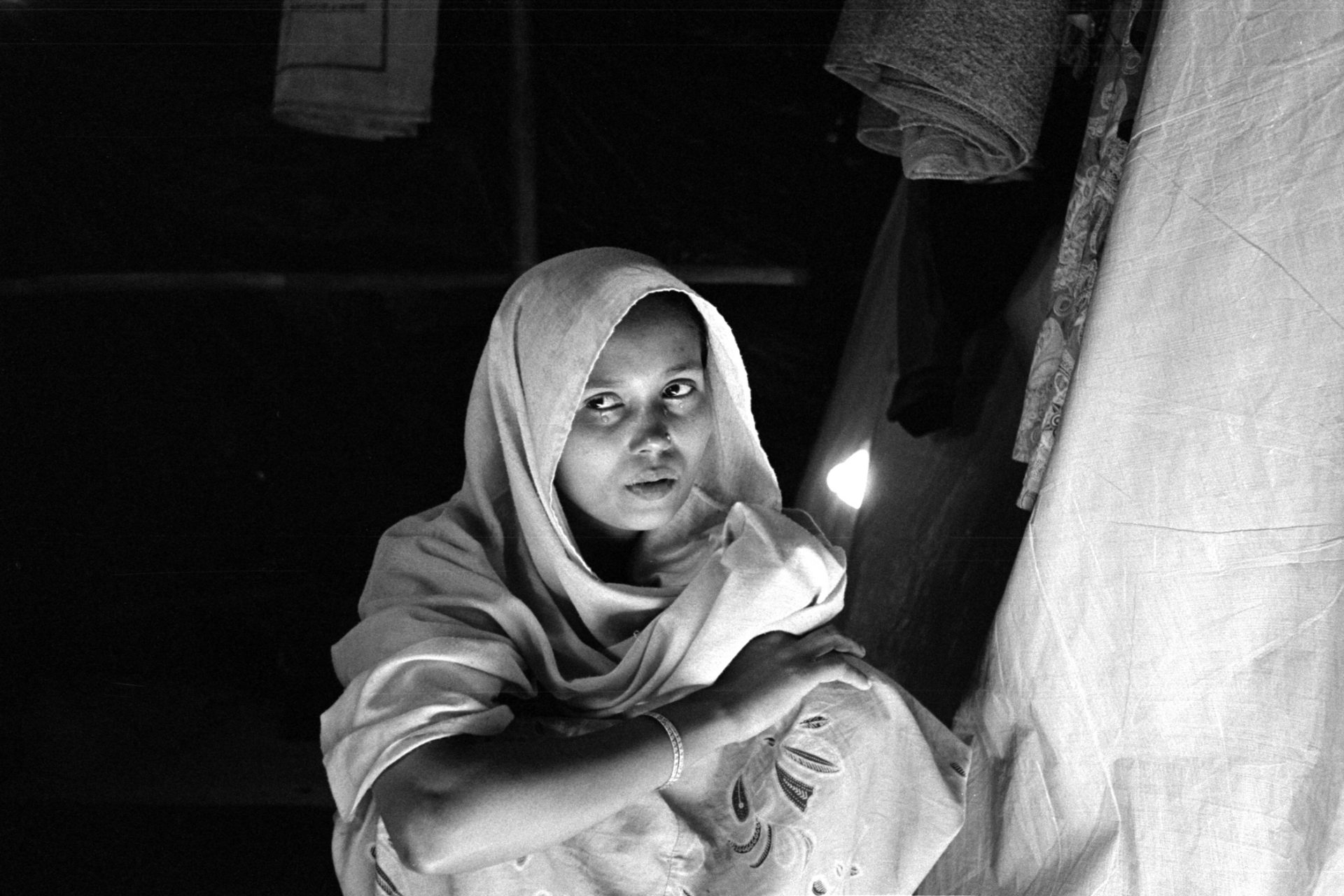 22 year old Rashida Begum from Tula Toli, Maungdaw sits in her makeshift hut at Balukhali refugee camp in Bangladesh.  Tula Toli was a scene of one of the largest scale massacres in Rakhine State in 2017.  Rashida's parents, sister and son were all killed by Myanmar's military.  She was taken into a shack with her sister and three other women where they were gang raped by Myanmar soldiers.  After being raped one of the soldiers slit her neck and left her for dead.  Miraculously, she survived the attack and made it across the border to relative safety in Bangladesh.