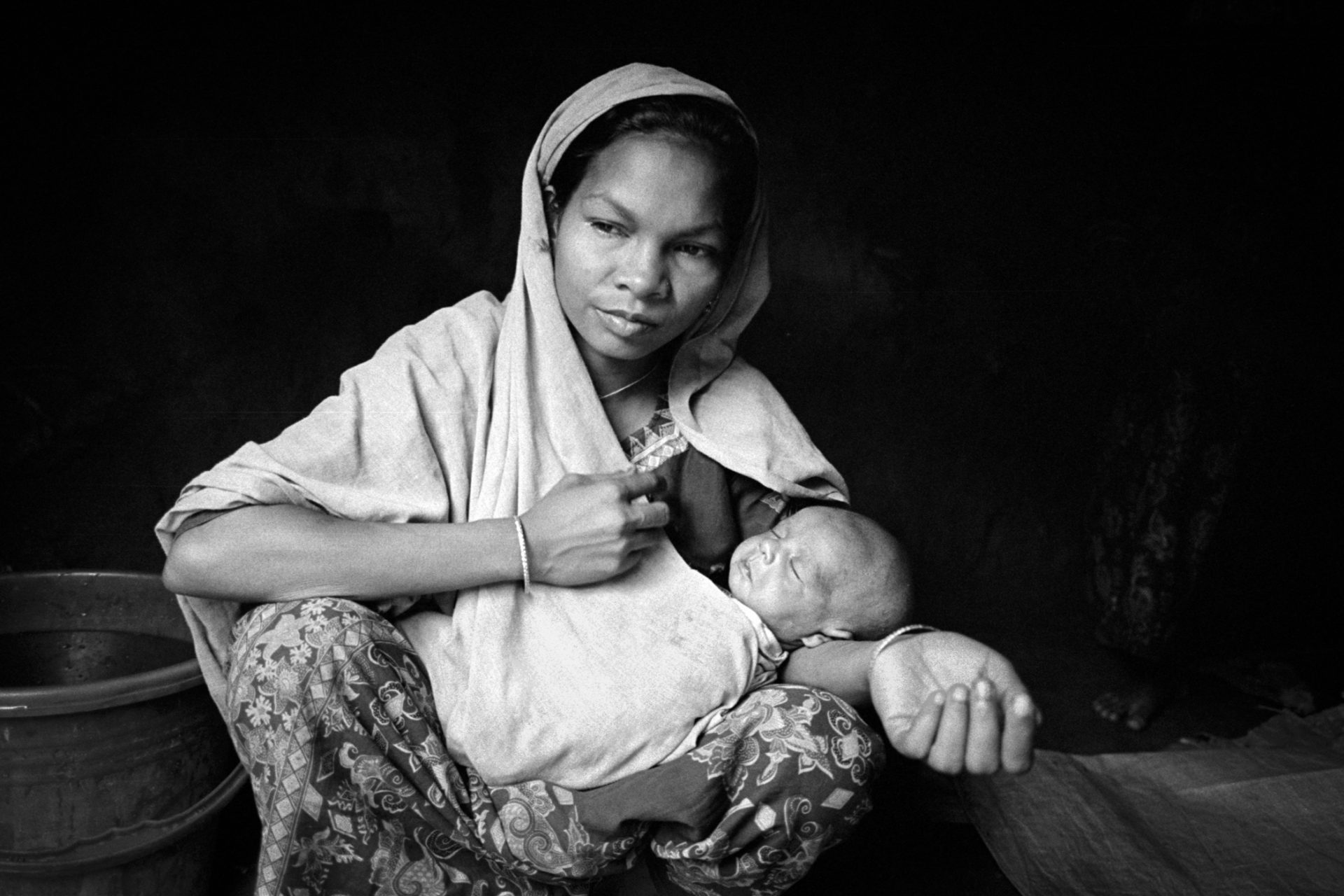 22 year old Lalu holds her 11 day old son Hafezul Mustafa at Zero Line camp along the Myanmar border at Naikhongchari, Bangladesh.