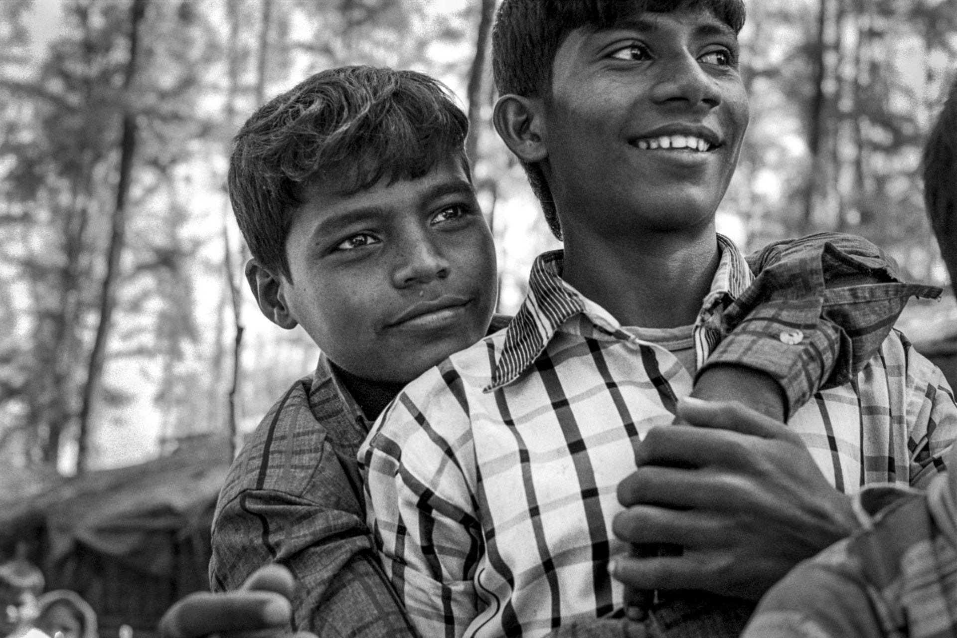 Rohingya boys embrace at Shamalapur makeshift refugee camp.  Shamlapur, Bangladesh.